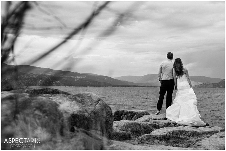 Okanagan Trash the Dress Vernon BC Rock the Frock session at Ellison Park.  The bride and groom enjoying a moment, watching the lightning across the lake. #trashthedress #rockthefrock  www.aspectartsphoto.com