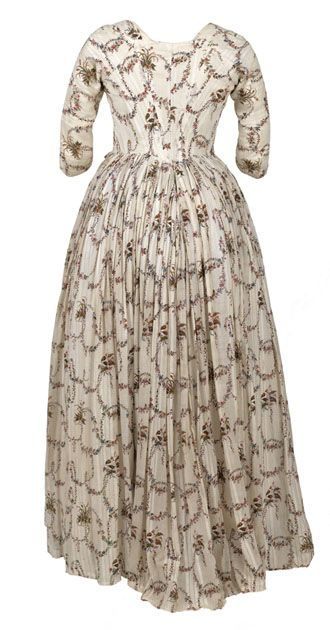 Cotton gown woven (back view) with fine stripes and printed with small floral sprays, 1785–90  © CSG CIC