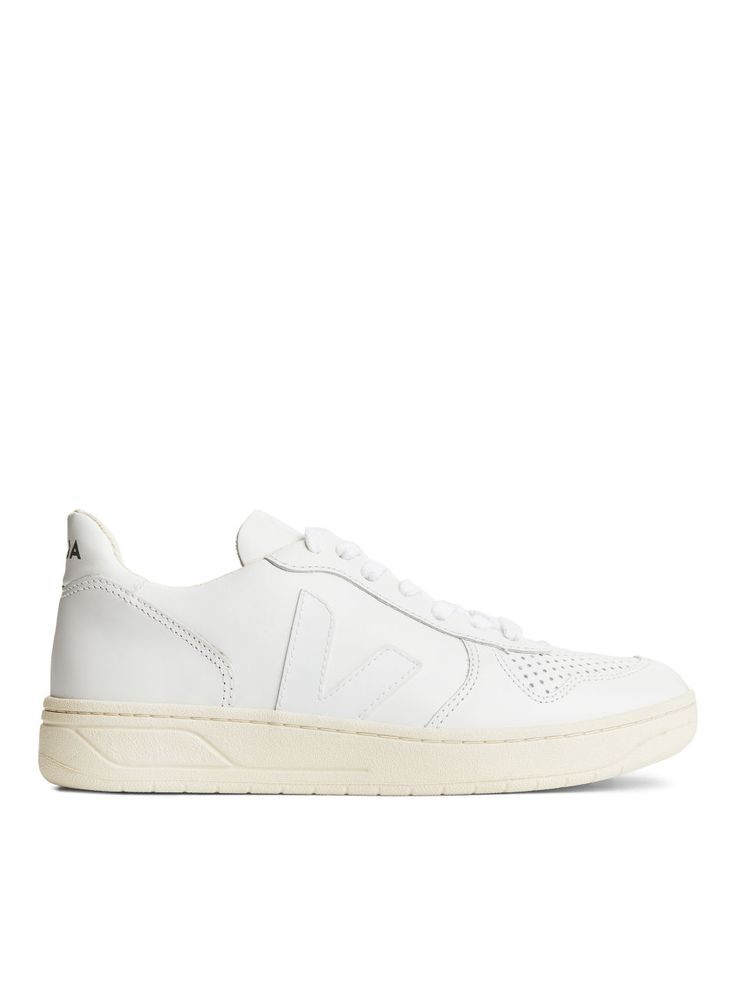 A cleanly designed, stable and comfortably cushioned athletic shoe made from ethically sourced and fairly traded leather and rubber, the V-10 silhouette wa