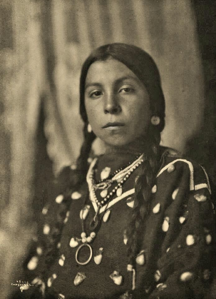 1906 photo of a Crow Indian girl called, Takes a Horse