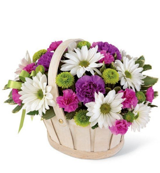 Floral arrangement in basket.  Many options available