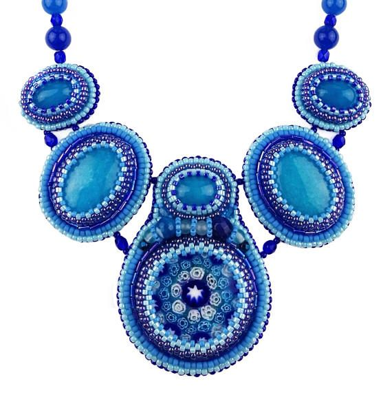 Bead embroidered statement necklace with Italian millefiori glass, jade cabochons snd beads and sterling silver findings. Designed & made by Agnaart https://www.etsy.com/listing/516970380/bead-embroidery-blue-gemstone-bib