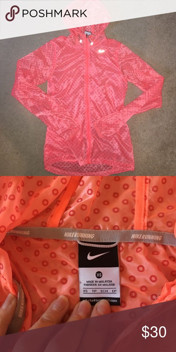 Nike running jacket Great condition: color is kinda like hot coral Nike Jackets & Coats