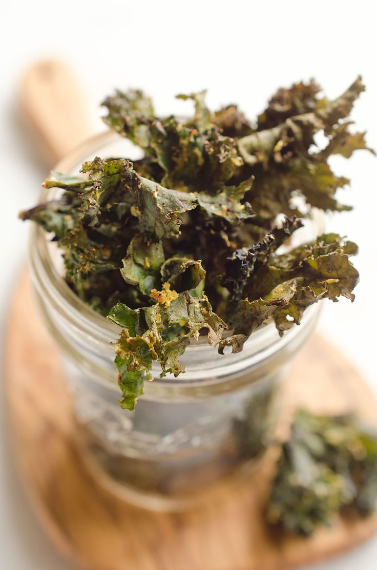 Spicy Kale Chips are beautifully crisp and loaded with bold chipotle flavor for a healthy 5 ingredient vegan snack. They are perfect for the munchies or paired with your favorite sandwich on the side! #Vegetarian #Snack #Healthy