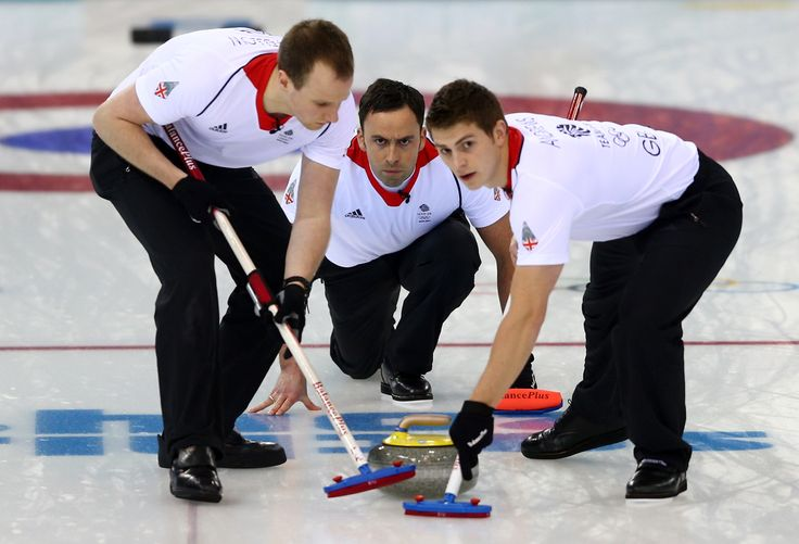 Team GB's silver medal winning curling team in action at the Sochi winter Olympic Games, 2014