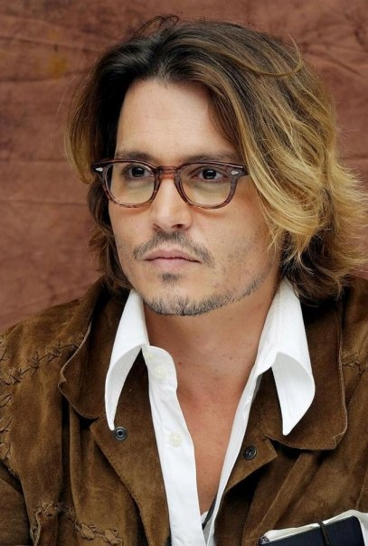 """Johnny Depp photographed """"Once Upon a Time in Mexico"""" Press Junket, August 24, 2003."""