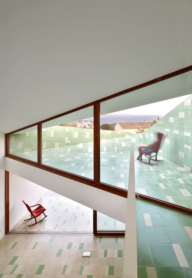Angular Windows Framed In Wood. Green Tiling Adds An Interesting Element To  The Interior Of