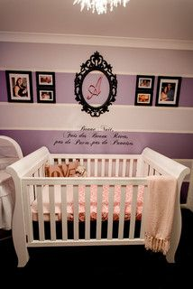 I'd do vertical stripes -- pastel light and dark purple, framed initials, hospital/pregnancy/family photos above crib, favorite quote stenciled/vinyl by bookshelves and reading corner
