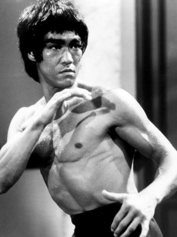 EC: Battleground Secondary Character: Iris like many of my characters doesn't fit a special ethic mold. Anyone could play him, but a fighter's physique would be necessary. How about a smash-up of Bruce Lee and Ray Park with tar skin.