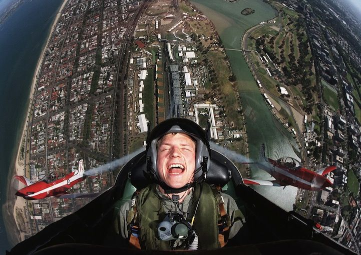 Formula One driver Kimmi Raikkonen shows us what pure happiness looks like. This photo was taken above the F1 Australian Grand Prix track at Albert Park in Melbourne. Appropriately, his nickname is Iceman. #travel #plane #happy #cool