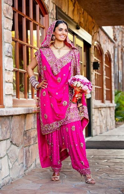 Who said you can't have a pink suit as your bridal outfit? Looks amazing and comfortable!