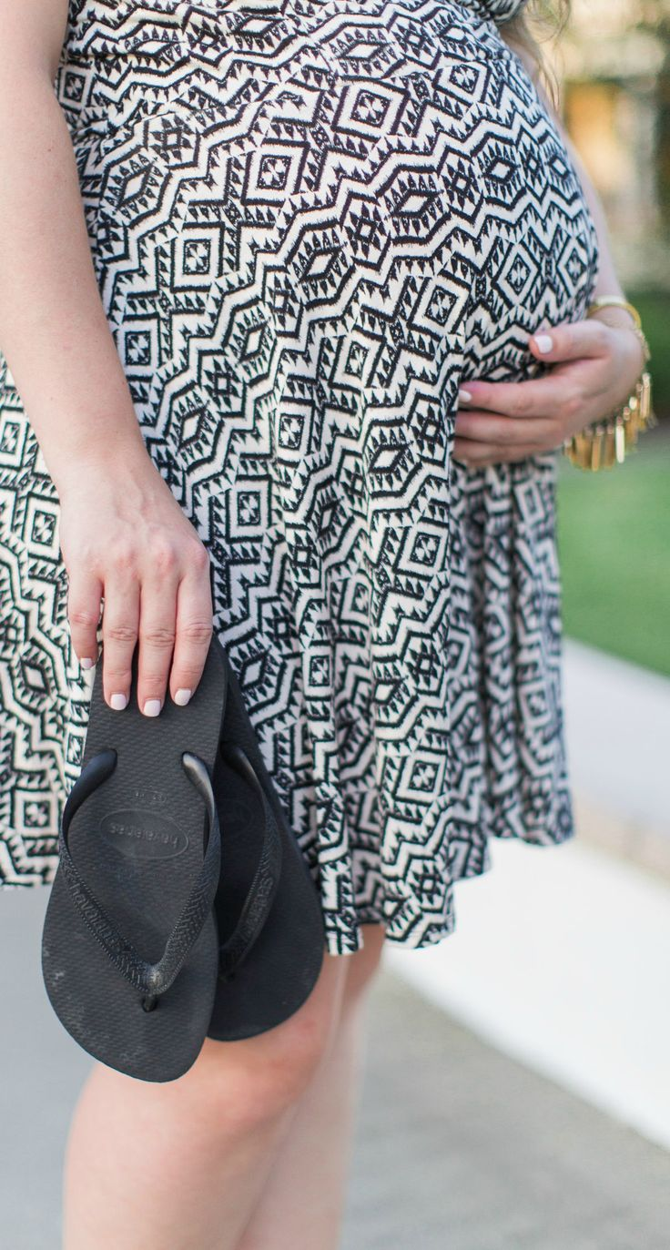 Every mama to be needs a pair of flip flops in her handbag to prepare for foot swelling! Click through this pin to learn more summer pregnancy essentials that will help you survive the heat with Orlando, Florida lifestyle blogger Ashley Brooke Nicholas #OwnIt sponsored by Special K | Summer pregnancy survival kit, maternity fashion, maternity outfit ideas, maternity tips, pregnancy tips, tribal print sundress, lace espadrilles, cat eye sunglasses, straw tote