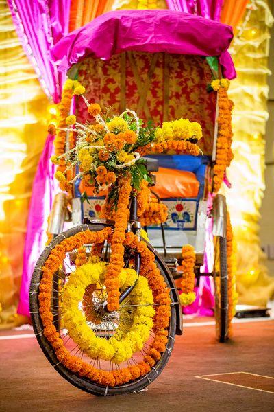 Mehendi Decor - Marigold Decor on a Rickshaw | WedMeGood  #wedmegood #indianbride #indianwedding #mehendi #mehandidecor #DIYdecor #rickshaw