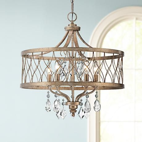 Let the extravagant elegance of this gold and clear crystal chandelier infuse your space with its