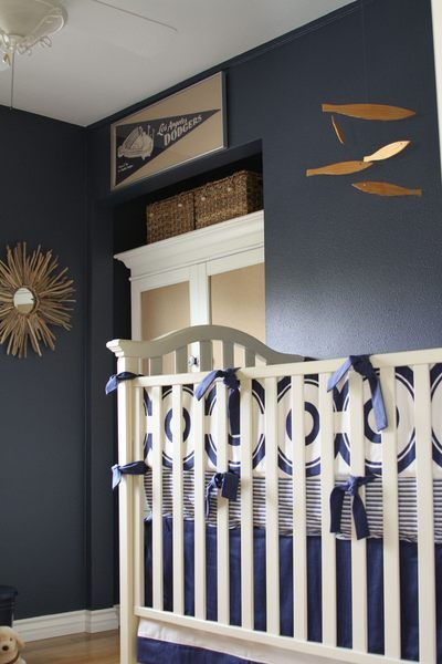 Love The Dark Blue Walls With White Crib And Gold Accents
