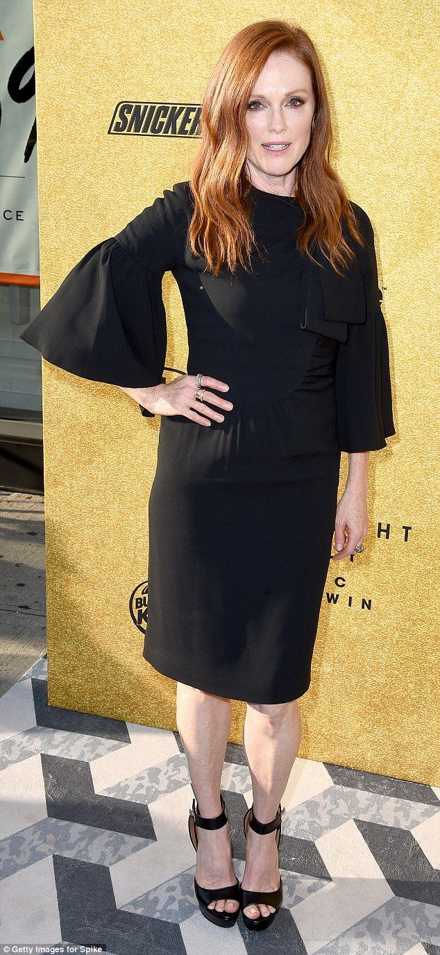 Dramatic: Julianne Moore, who starred with Alec in the film Still Alice, showed up to sing his praises, wearing a knee-length black dress with bell sleeves