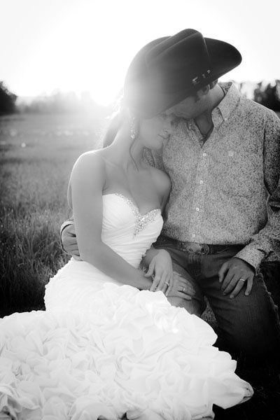 ♥ I love the way the guy looks in this photo. She's beautiful but it's the way he is holding her and the way he is dressed. Every girl wants her cowboy. Yummy.