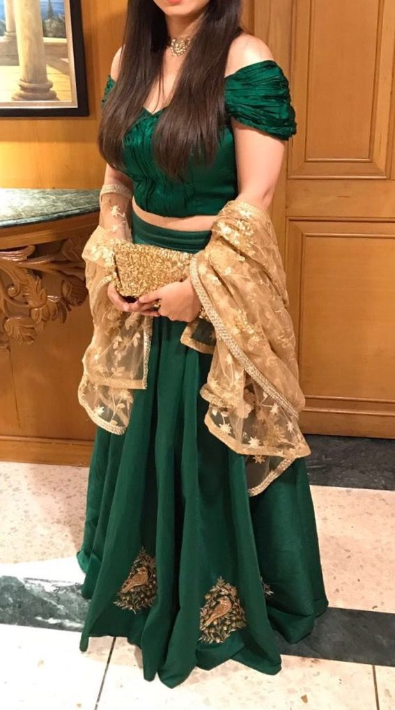 *The Kiera Off Shoulder Lehenga*  A sexy blouse, floral dupatta in the perfect shade of gold, and a luxurious skirt with birds on it. This Lehenga set literally has every wedding trend in one place!  Shop on our website. Link in bio.  For custom orders email: ayesha@thepeachproject.in  #bottlegreen #green #lehenga #sari #thepeachproject #indianfashion #desistyle #saristyle #sariblouse #americandesi #winterfashion #indianfashion #indianwedding #desibridesmaids #torontolife #californiagirls
