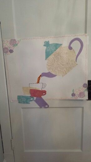 Pin the teacup under the teapot game for a Tea Party Birthday made with posterboard, markers, and color textured paper