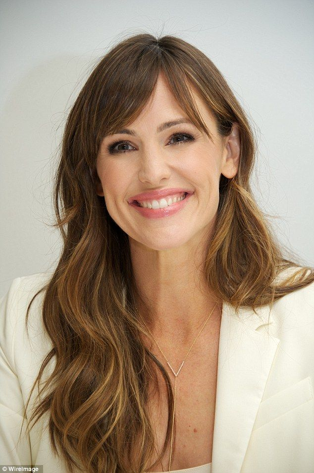 Jennifer Garner: The 42-year-old looked radiant in a cream blazer over a white top and accessorized with a gold body chain