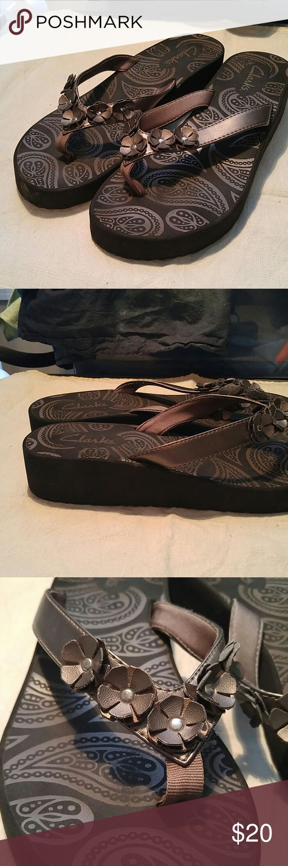 Clark's Pewter Floral Wedge Flip Flops Size 9 Clark's Pewter Floral Flip Flops. Size is worn off but it is an 8 1/2- 9 that is what I wear. Great condition!! Clark's Shoes Sandals