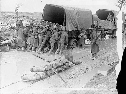 Canadians giving a lorry a helping hand on a shell battered road on Vimy Ridge. April, 1917.