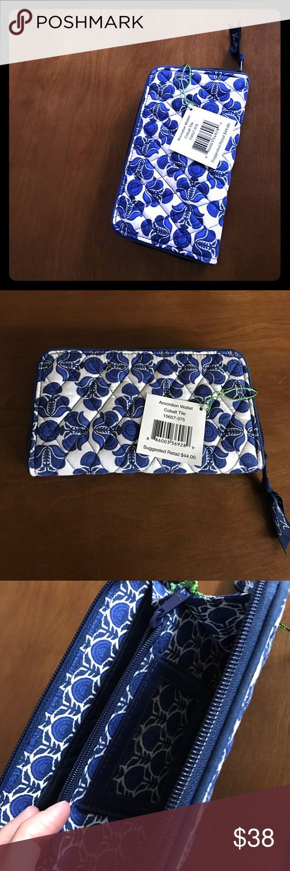 NWT Vera Bradley clutch Beautiful blue and white pattern brand new with tags.  Has a slot inside for license and also 12 credit card slots. Plus both sides could hold coupons or cash. And has a coin pouch in the middle! Very convenient and cute! Vera Bradley Bags Wallets