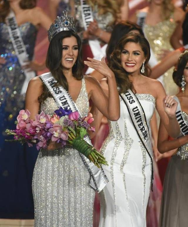 Miss Colombia Paulina Vega, left, is crowned Miss Universe 2014 by Miss Universe 2013 Gabriela Isler during the 63rd Annual Miss Universe Pageant at Florida International University on Sunday, Jan. 25, 2015.