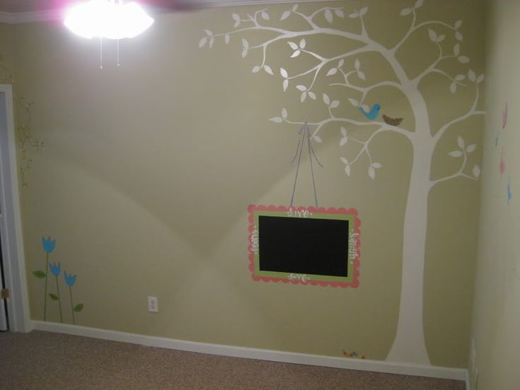 painted tree with a chalkboard hanging off