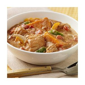Peanut butter, zesty tomatoes, and bell peppers combine with chicken and sweet potatoes for a slow-cooked meal with an African influence.