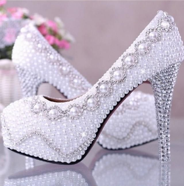Weddbook is a content discovery engine mostly specialized on wedding concept. You can collect images, videos or articles you discovered organize them, add your own ideas to your collections and share with other people - Weddbook ♥ Amazing white pearl rhinestones high heels bridal wedding shoes. White platform wedidng shoes with rhinestones heels and pearl detail. Sparkly cheap and comfortable wedding shoes. Sparkly high heels evening shoes. pearl white sparkly bridal gift #pearl #rhinestone…