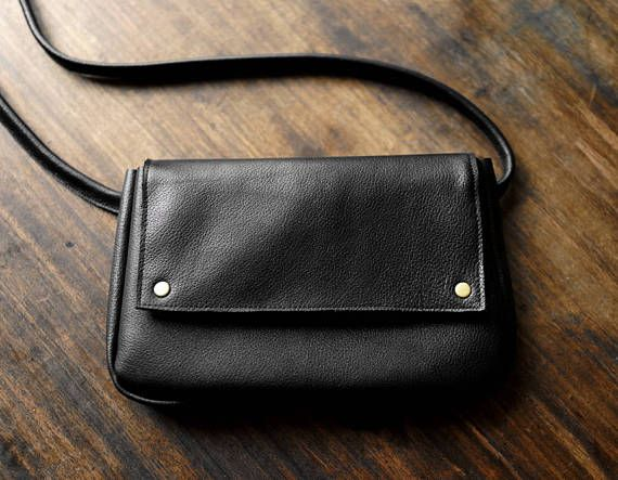 Universal and elegant leather fanny pack. Holds whatever you may need it to hold, phone, coin purse, card holder, usb, a few keys, etc. Made of soft genuine black leather. Close with old gold snaps. Adjustable strap 12mm / 0.5, lenth up to 95 cm/37,3. If You want longer strap please write to me. Dimensions: h: 14 cm /5,5 w: 23 cm/ 9  Possibly to make crossbody purse with long strap. Ready to ship in 2-3 working days.  Standard delivery time:  European union: 4 - 10 days  E...