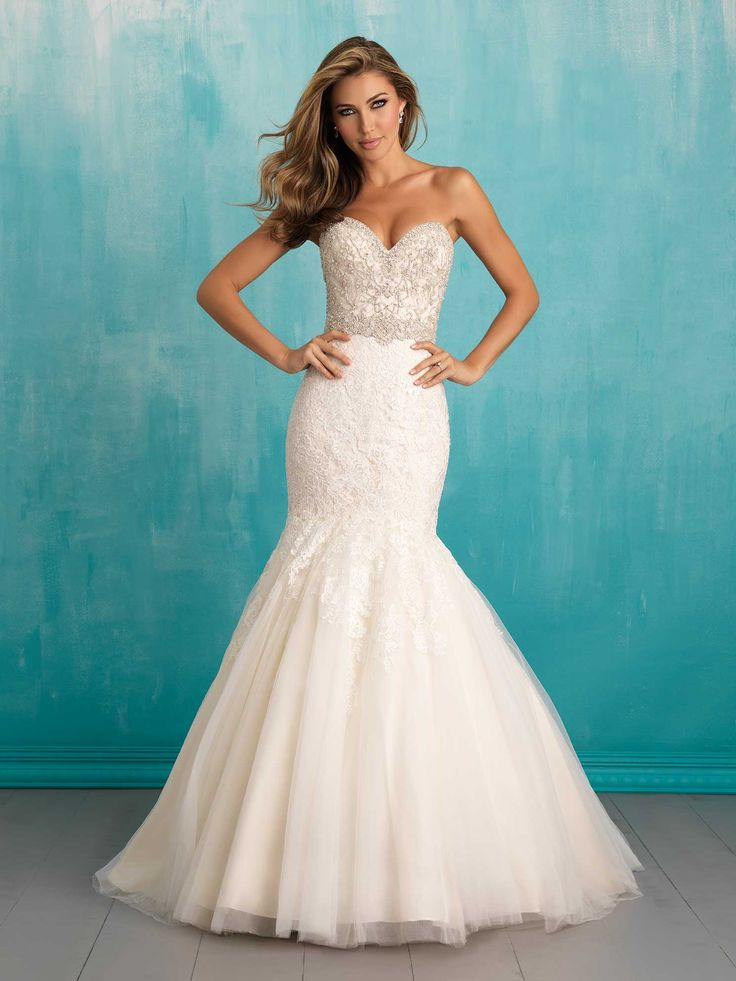 Allure 9305. Designed with dramatic texture, this form-fitting gown features Swarovski beading, lace and sheer tulle.