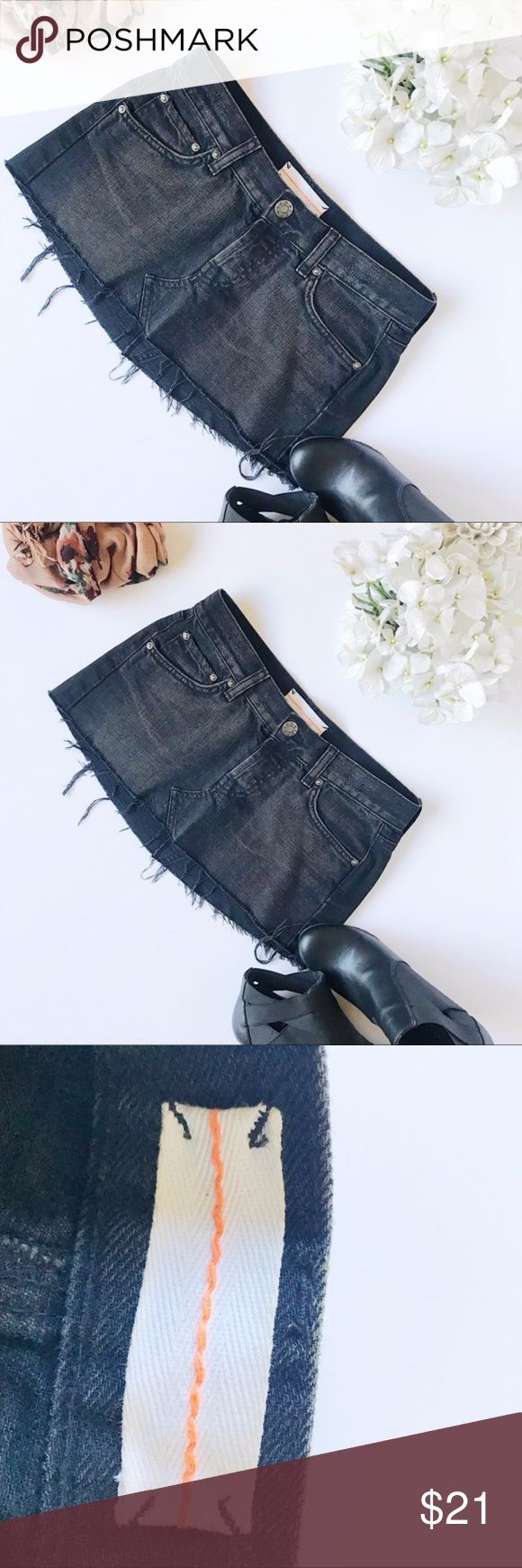 Top Shop MOTO Black Jean Mini Skirt Top Shop MOTO Black Jean Mini Skirt Such a cute jean skirt to add to a really cute pair of leggings. This is a distressed look. With almost a brown distressed wash in the front.*69 –79 Topshop Skirts Mini