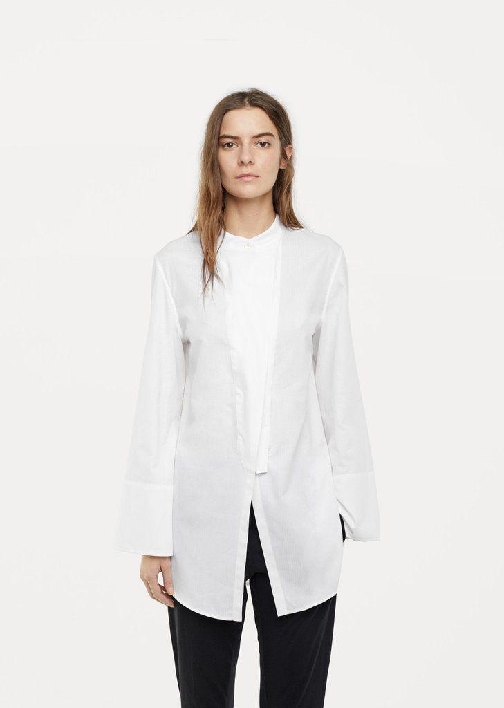 Shop Cutout Shirt from Ann Demeulemeester at La Garçonne. La Garçonne offers curated designer goods from luxury and emerging designers.