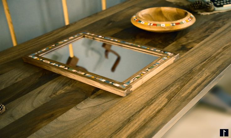 The mirror in walnut frame: This rustic product was made from the walnut tree and surrounded with the handmade ceramic objects.