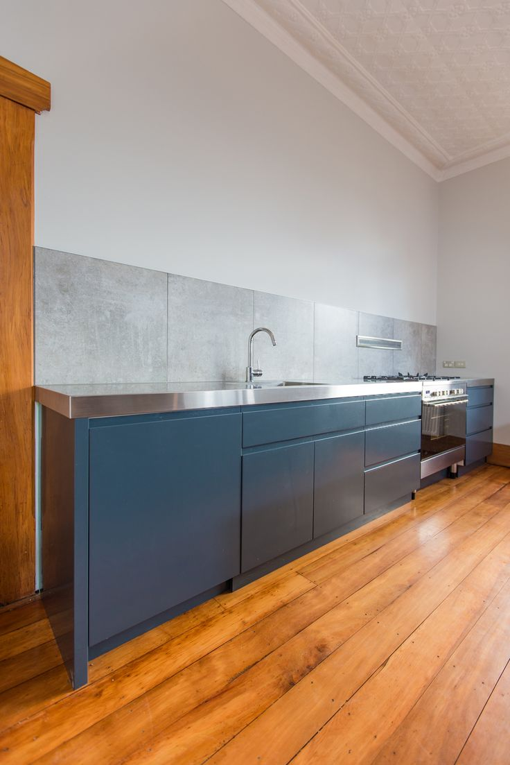 Kitchen 440. By Sally Steer Design, Wellington NZ.  Concrete look tiles with 900mm downdraft extractor.