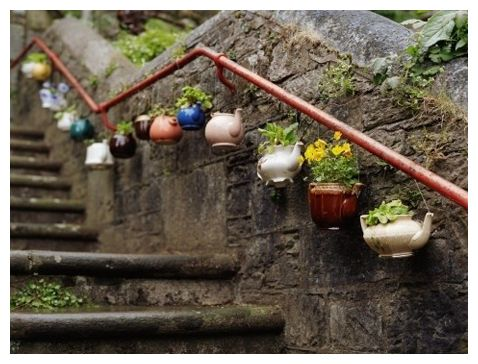 Upcycling teapots for outdoor vases.