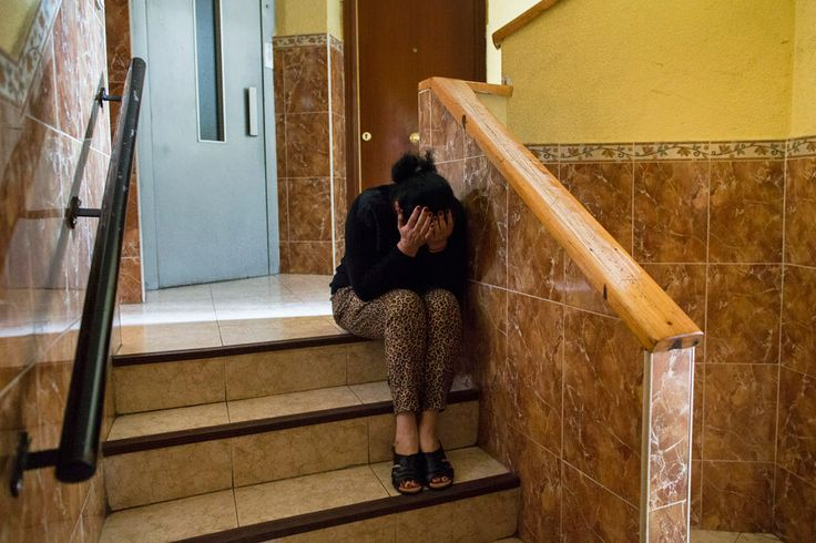 Carmen Escudero Garcia, 59 years old, cries as she waits for the police to evict her son, Jose Garcia Escudero, 39, and his family in Madrid, Spain, Monday, May 19, 2014. Escudero and his 30 year old wife Raquel de Cadiz Escudero, have 5 children and they occupied a Banco Popular bank apartment over a year ago and they cannot afford to pay the rent with a low income of 600 euros ($823) a month. The apartment has been sold to an investor group that now demands the eviction of the family. The…