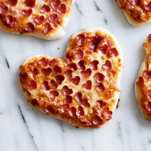 Heart pizza! Click through for 35 amazing, over-the-top Valentine's Day ideas, including Valentine's crafts, Valentine's recipes, and Valentine's decorations, and more!