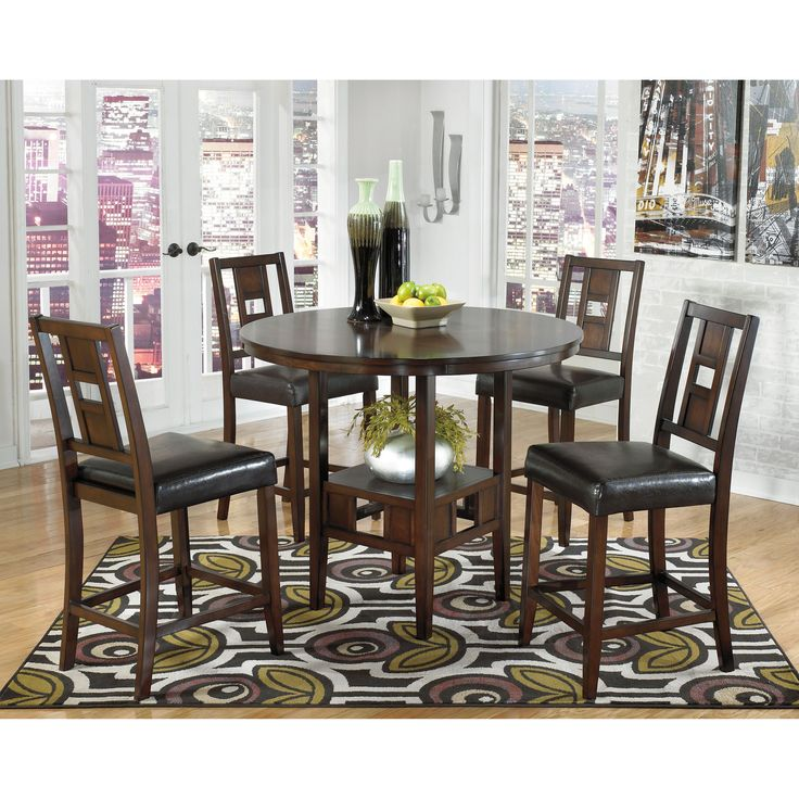 Exhibit contemporary style in your living space with the Logan dining table set. The counter height dining table is uniquely designed with a lower shelf that is perfect for storing place settings and other dining accessories.