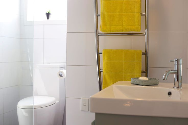 #modern bathroom. #yellow towels. Staging by Places and Graces.