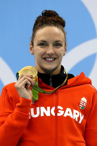 Gold medalist Katinka Hosszu of Hungary poses during the medal ceremony for the Women's 100m Backstroke Final on Day 3 of the Rio…