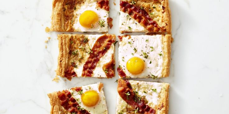 """This sunny-side-up """"pizza"""" recipe is an egg-cellent idea for Saturday brunch."""