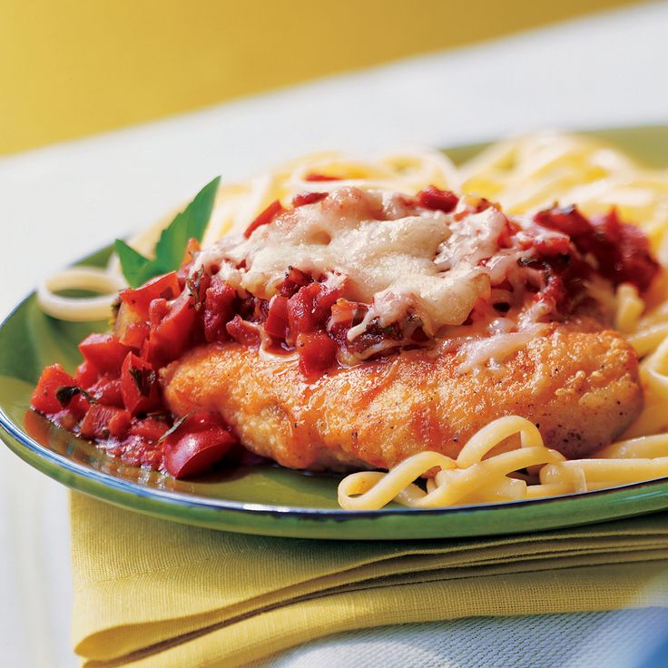 Try Asiago or provolone cheese in place of the mozzarella in this winning recipe for chicken parmesan.