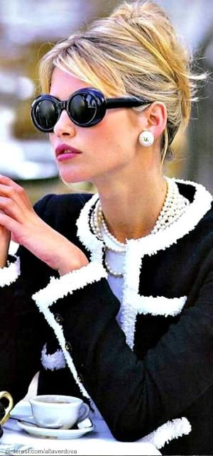 cafe by jacqueline - I love the sweater!  I wonder if she knows how silly she looks with her mouth like that?  She puts on an elegant sweater, elegant jewels, has an elegant up-doo, Jackie O. - type glasses and a duck pout.  Yeah, that's a power pose!