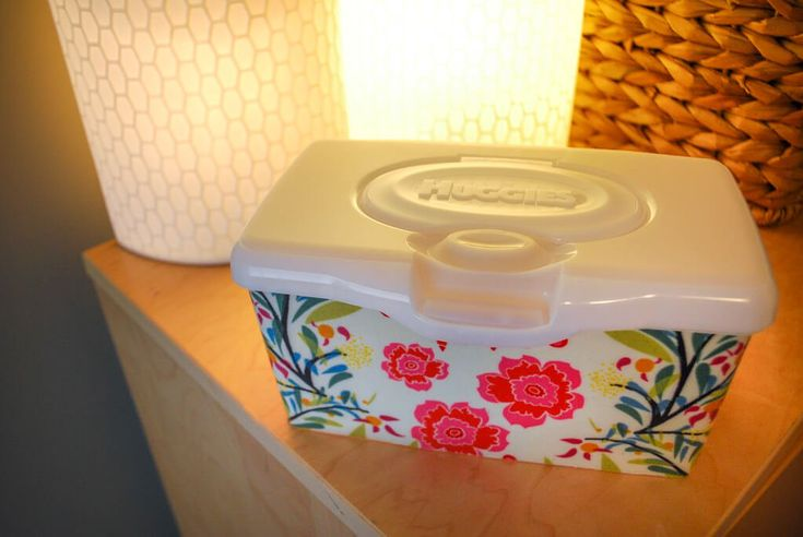This DIY baby wipes container craft will put the finishing touch on your nursery decor. DIY baby wipes container craft to match nursery decor. Use Mod Podge to add pretty fabric to refillable baby wipes containers - no need to hide your wipes box anymore!