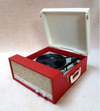 I remember playing my 45's on a record player a lot like this one!
