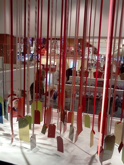 Hanging ribbons with Price TAGS window display that is a fantastic idea for your holiday booth.