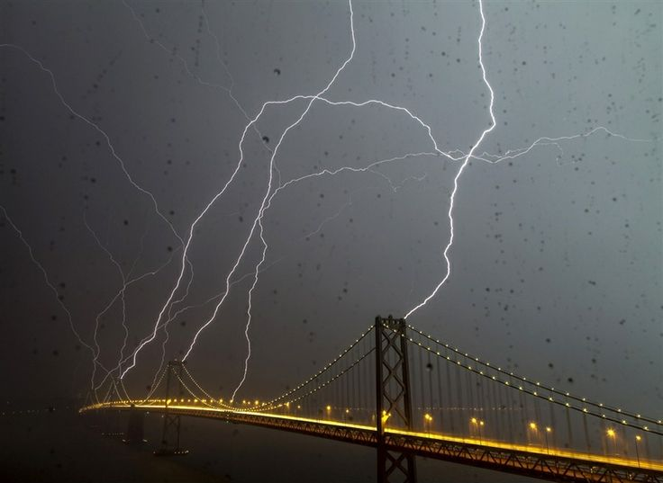 photoger Phil McGrew snapped this amazing pic of EIGHT lightning bolts hitting the Bay Bridge in SF